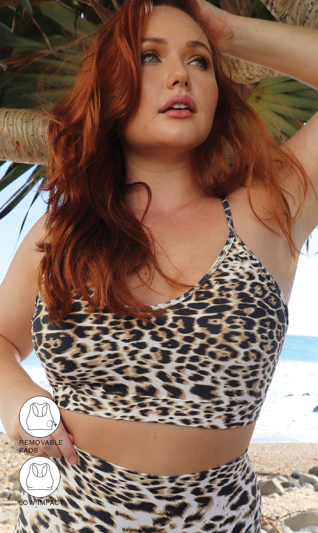 Front View: Lady wearing brown & white cheetah print momentum bra under palm tree