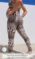 Side View: Pregnant lady in ultra high waist, brown and white cheetah print leggings & matching racer back bra