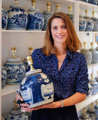 Company founder kate sbuttoni holding ginger jar table lamp
