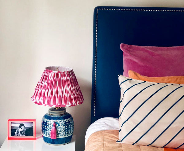 Double happiness ginger jar base with pink ikat shade bedroom