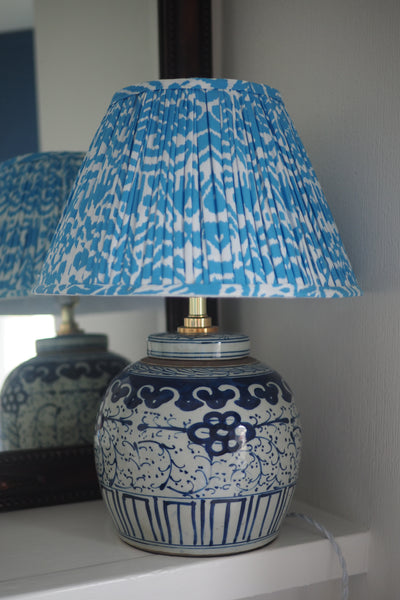 Turquoise ikat lamp shade with ginger jar lamp base