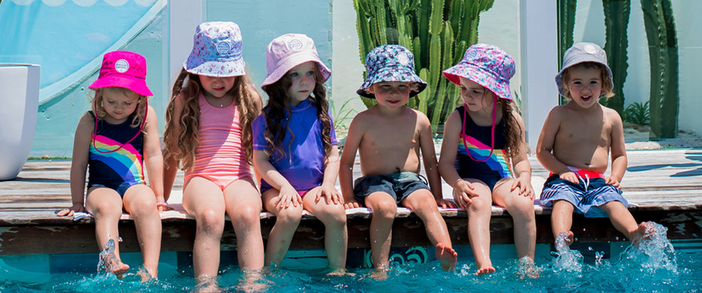 Cute Kids wearing wearing Little Renegade Bucket Hats in a range of designs