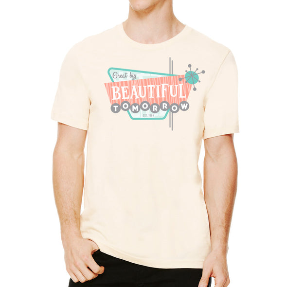 Male model wearing soft cream unisex tee with retro design Great Big Beautiful Tomorrow based off Disney attraction