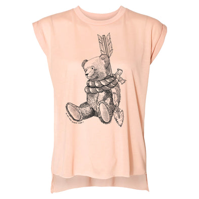 Front of Michaels bear ladies tee a peach color tee with a teddy bear roped around an arrow inspired by peter pan