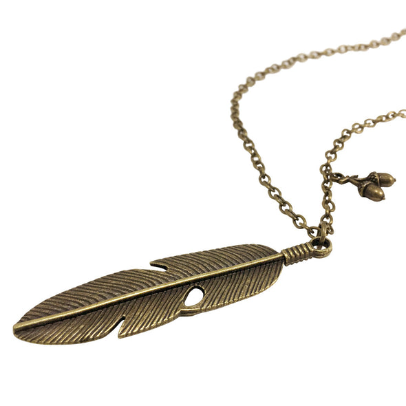 laying down pans feather bronze necklace with acorn detail inspired by peter pan