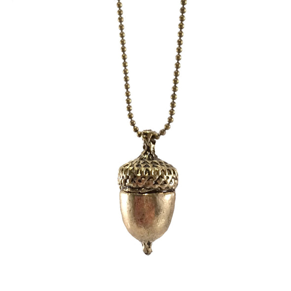peters kiss gold-toned necklace adorned with peter pans acorn