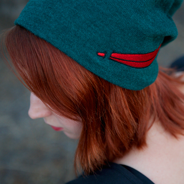 model wearing the original green neverland slouchy beanie inspired by peter pan and the lost boys
