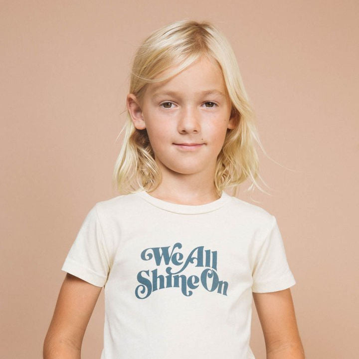 T-SHIRT 'WE ALL SHINE ON'
