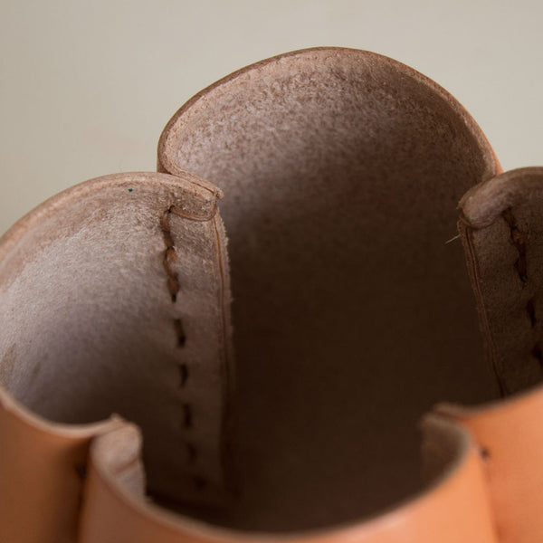 detail of the interior of a tanned leather pot