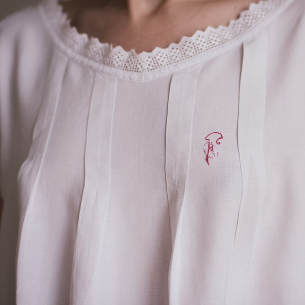 Embroidered cotton vintage dress. detail from the embroidered initials
