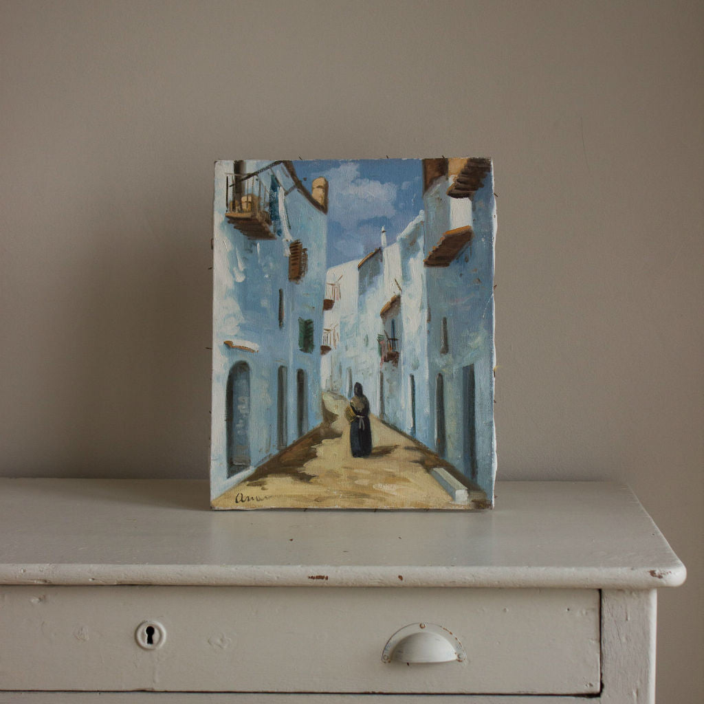 Frameless painting of a woman in a traditional local dress walking through a street of a village in Ibiza
