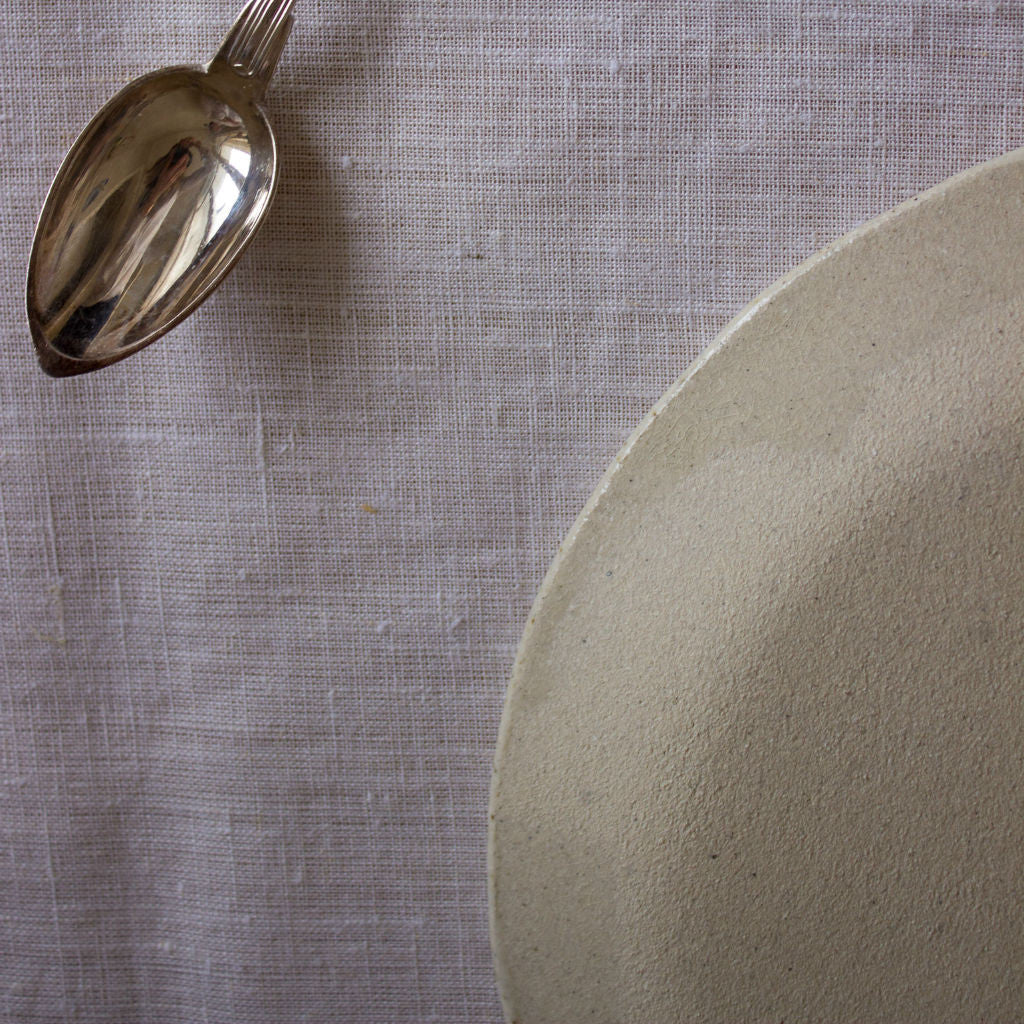 Back of the clay plate and vintage spoon. Handmade in Mallorca.