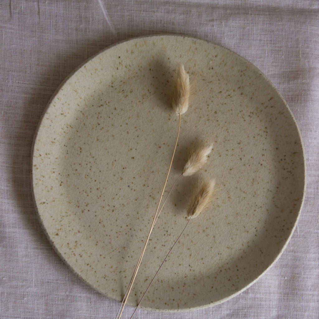 Clay plate coated with ashes from local pines. Handmade in Mallorca.