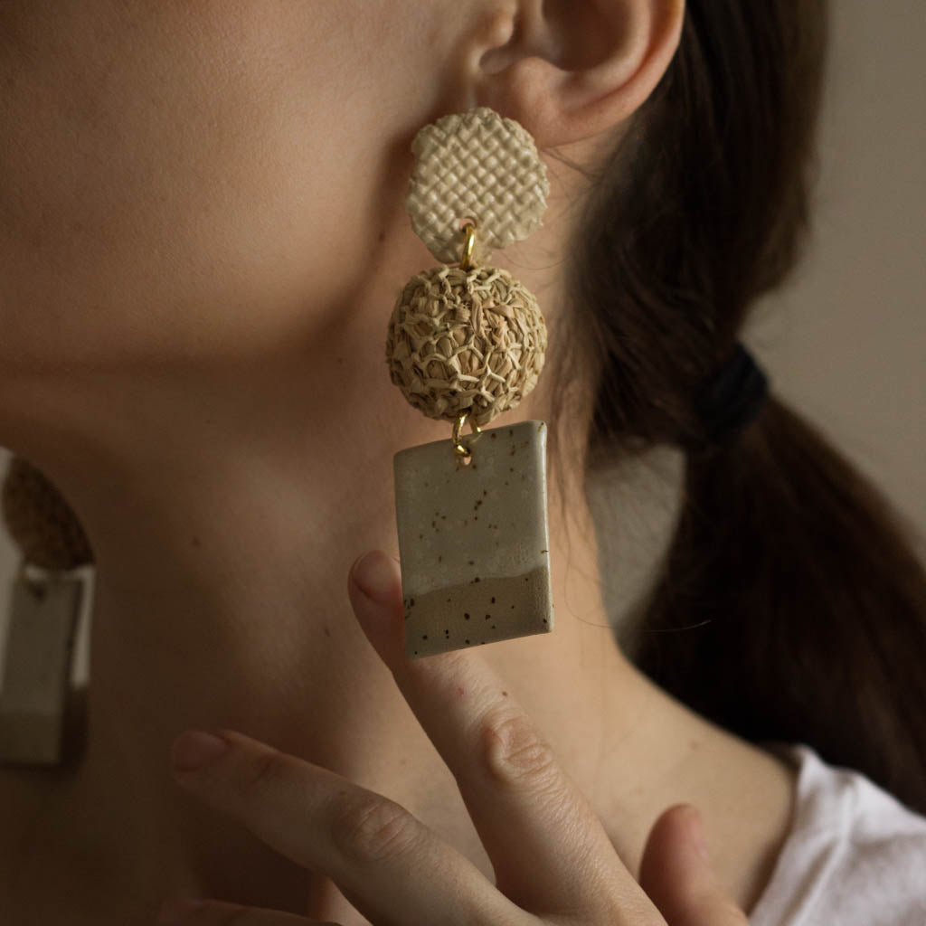 ceramic and raffia earrings from verbena and sabellar