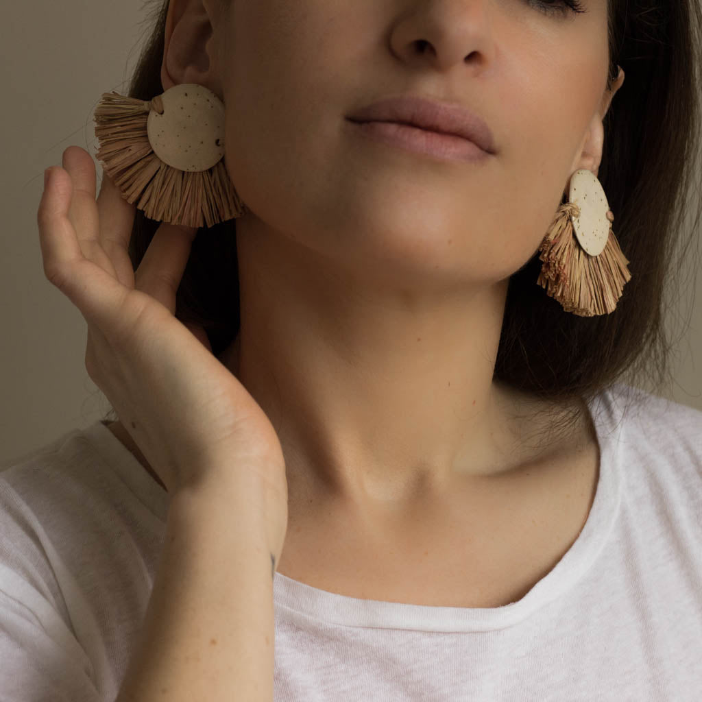pair of earrings. ceramic and raffia earrings from verbena and sabellar.