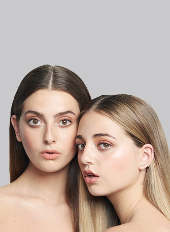 Nudestix sisters wearing Nudestix makeup products