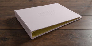 custom photography portfolio book in calamine and yellow backcloth for award winning photographer