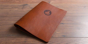 brown leather personalised menu with blind embossed branded logo hand made by hartnack and co
