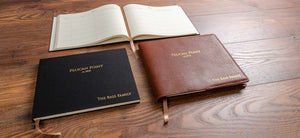Custom made visitor guest book with personalised cover and leather cover