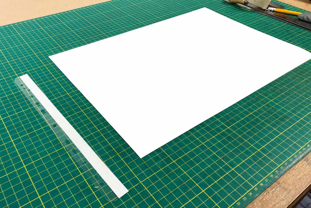 the first step of attaching hinge strips to portfolio book