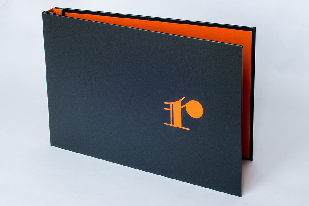 Orange Foil on Charcoal Buckram on custom portfolio