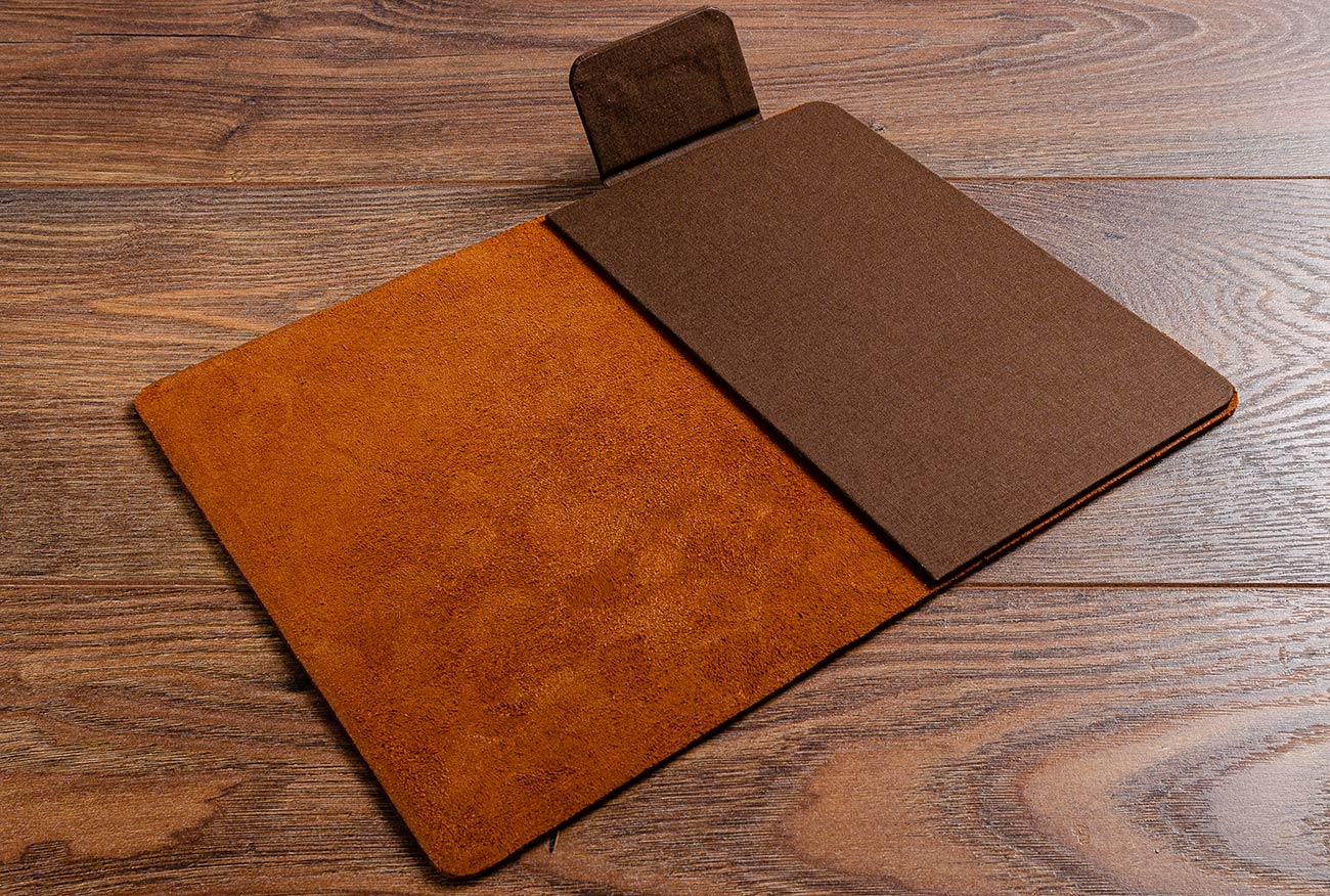 The inner cover of the leather bill fold is covered in Colorado book cloth and has a magnetic flap.