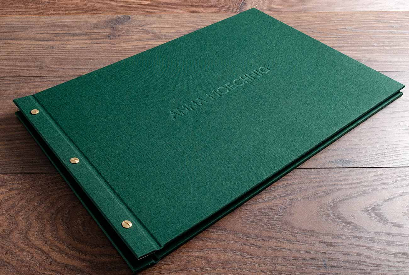 Exposed screw post portfolio book in flint green book cloth with blind debossed name