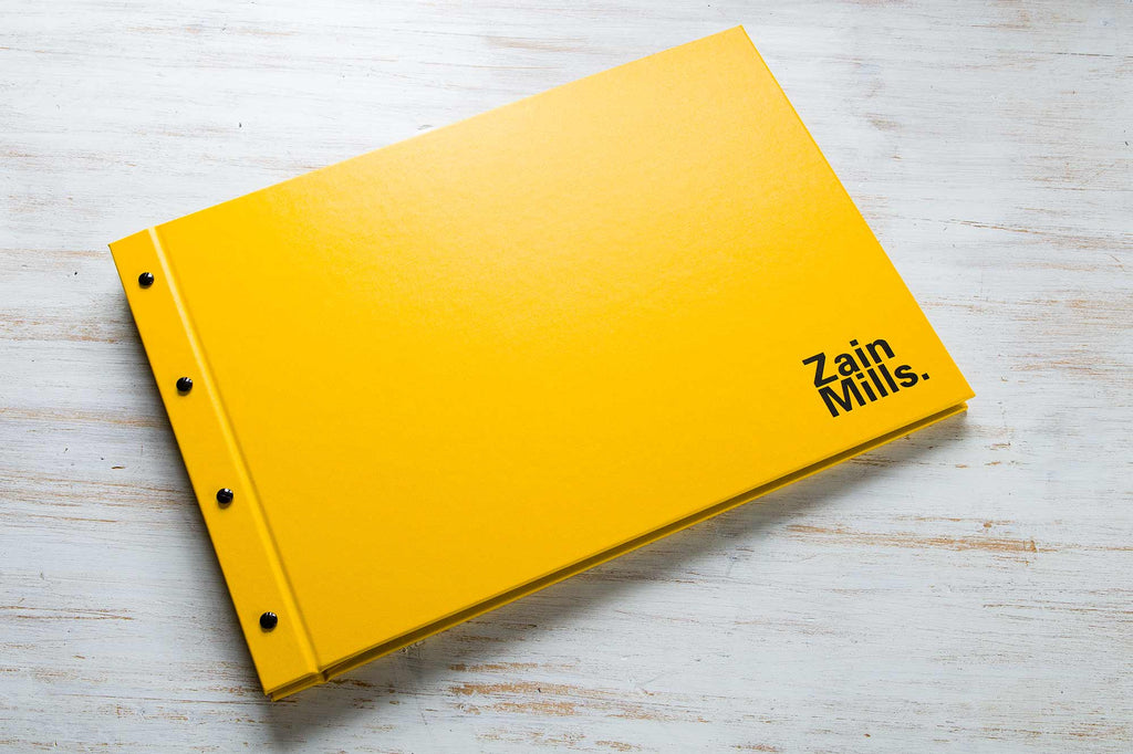 A3 photographers portfolio book in yellow buckram and black foil personalisation