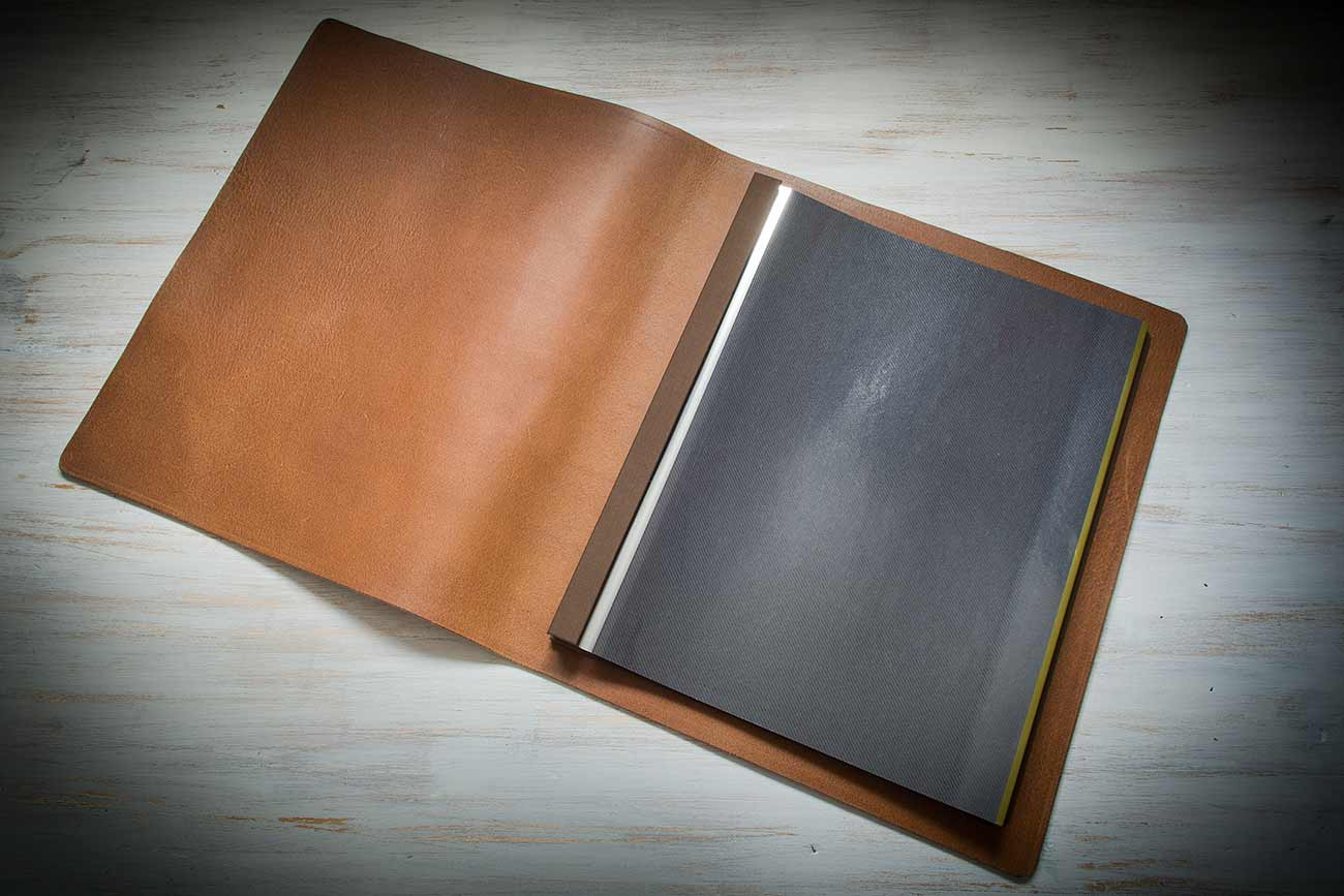 Leather wedding album with plastic inserts