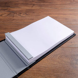 A4 white pages in a luxury hand made guest book binder with high quality white card stock that have been drilled and then scored. The pages have been inserted into the guest book with crew posts and hinge at the spine.