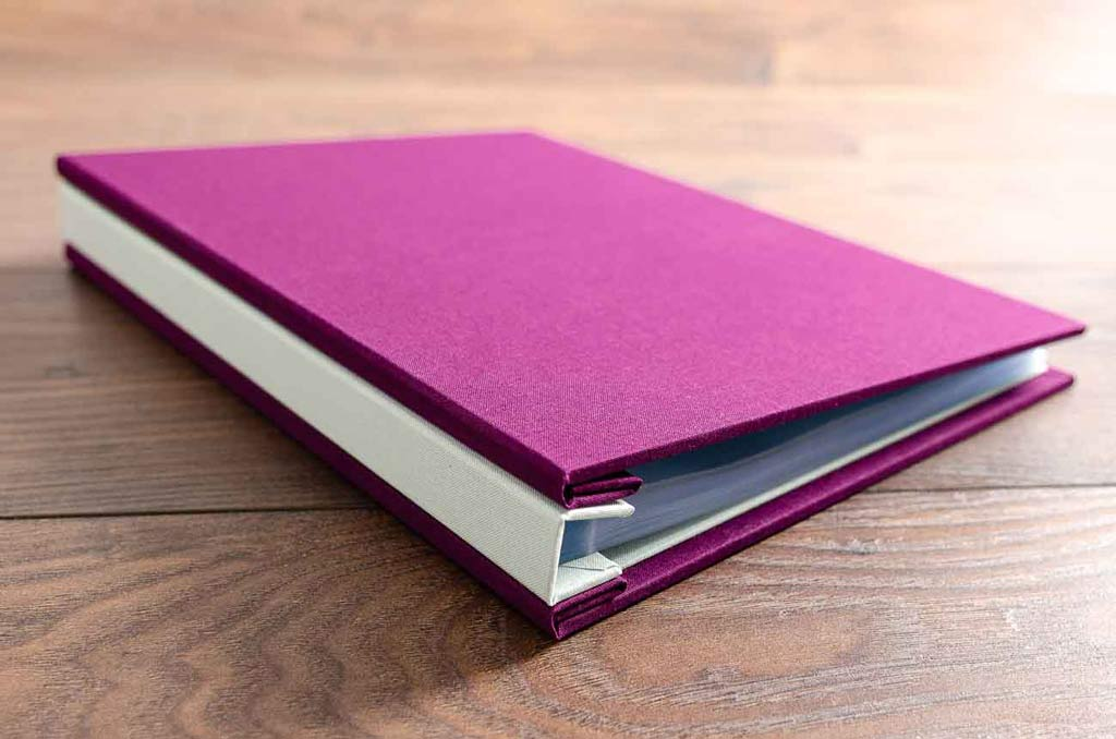 A4 portrait portfolio book on purple and green for fashion and textile student