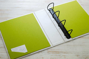 custom ring binder portfolio with black binder mechanism and cream coloured cover