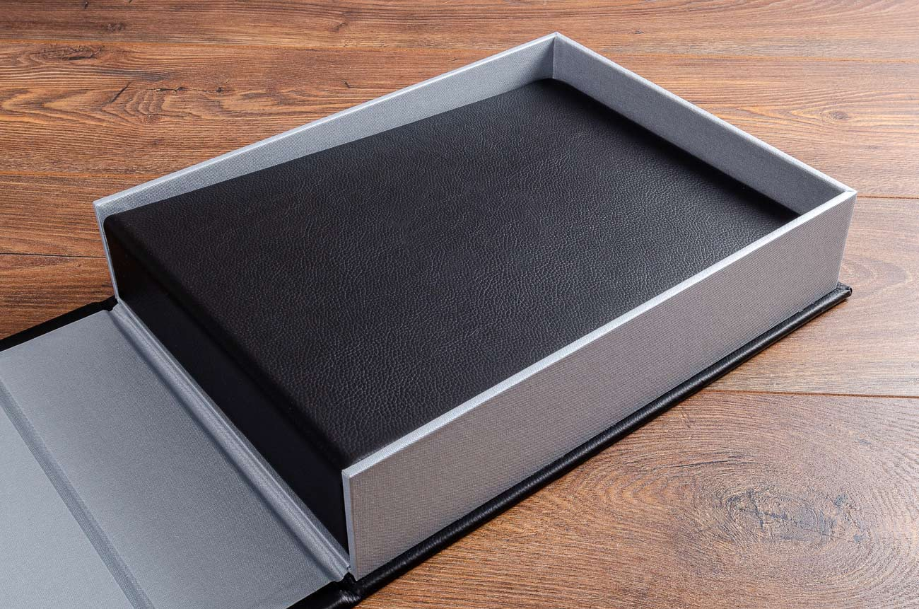 A4 landscape black leather guest book inside its clamshell box holder (personalisation removed)