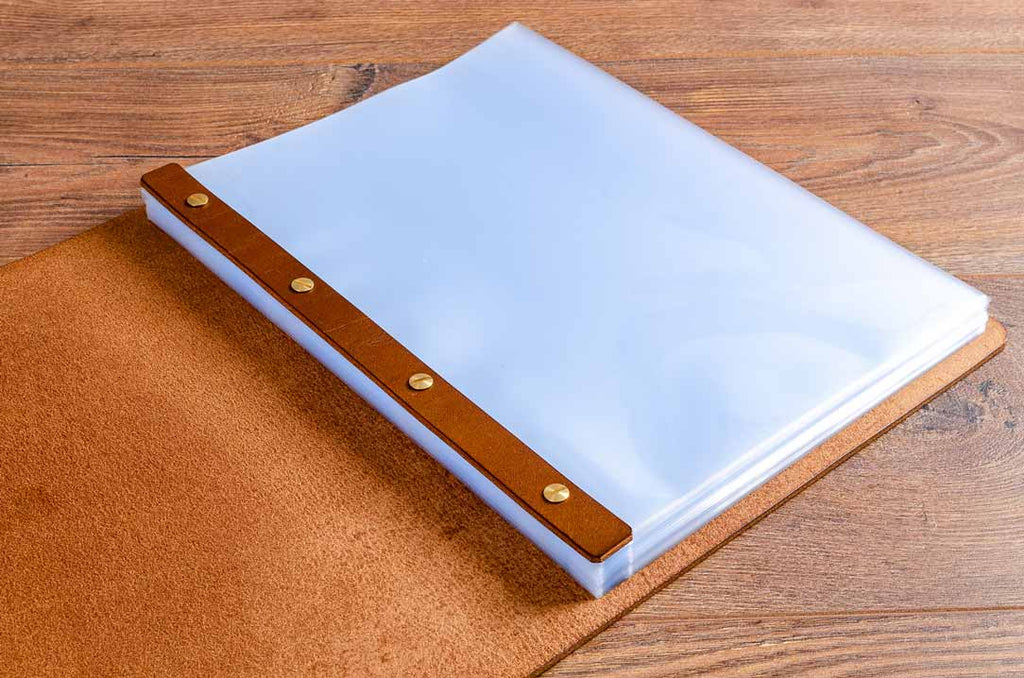 the plastic page protectors are held into the leather menus with screw posts