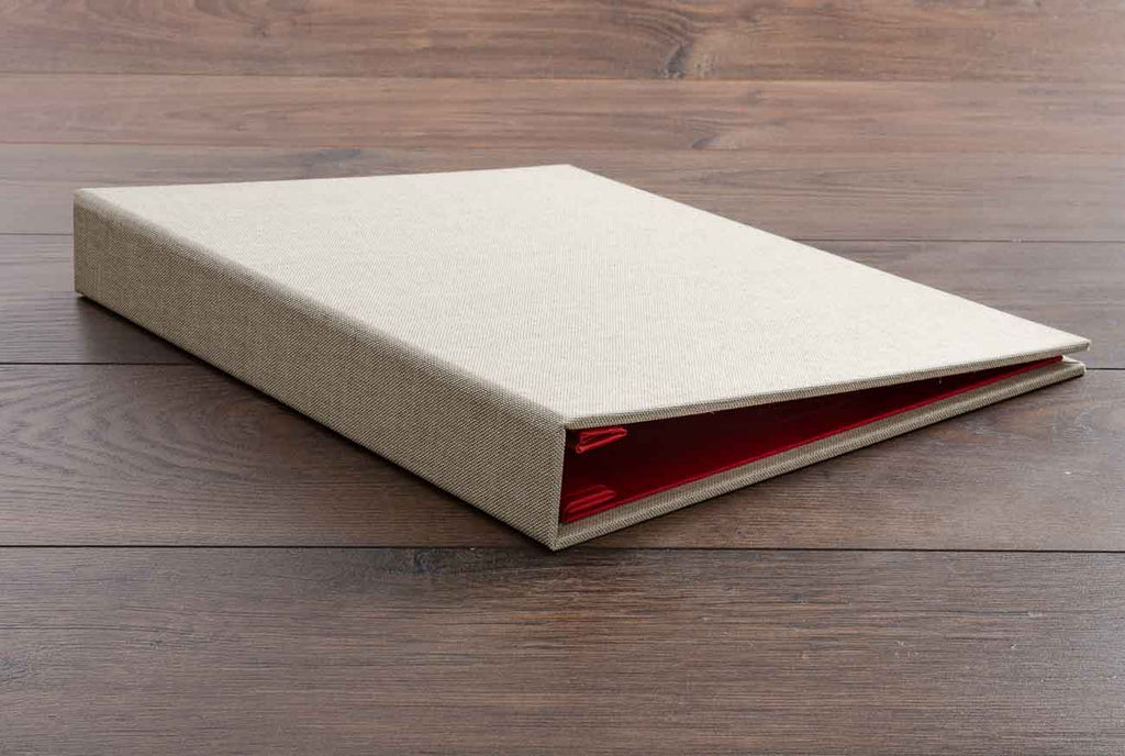 A4 case bound portfolio book in Medium linen and Alton red book cloth