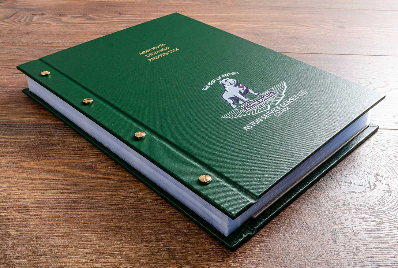 Bespoke vehicle document holder for a vintage Aston Martin for Aston Martin Dorset. The exposed screw post binder allows for more pages to be added