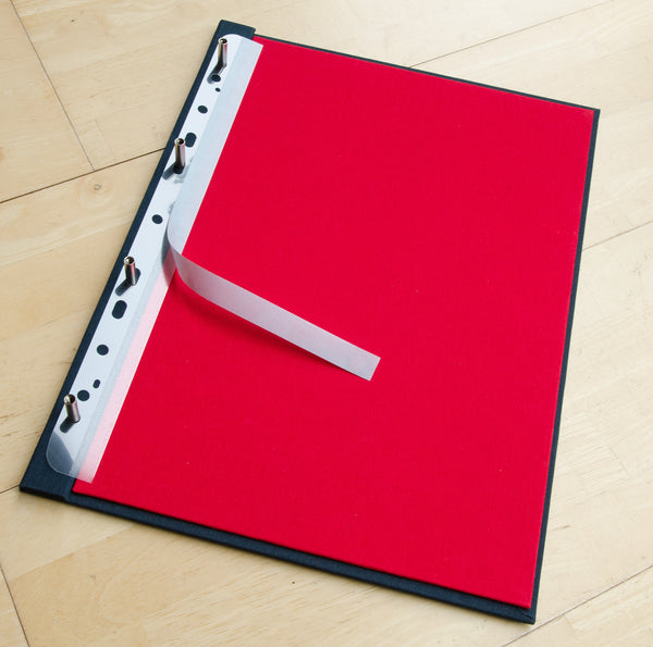 Filing Strips that have holes punched in one end and adhesive tacky strip on other to attach paper or card that can then be placed in file or folder