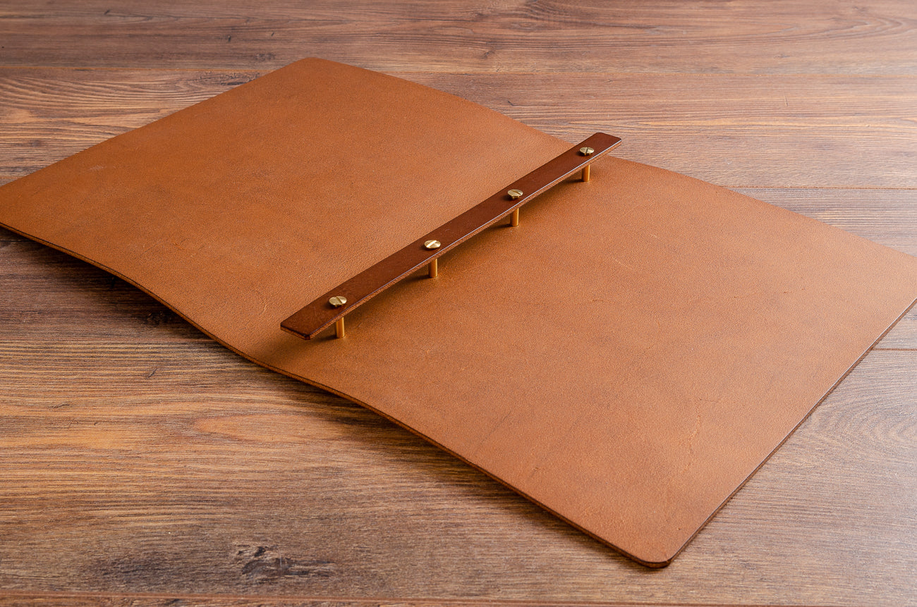 Inside of the leather menu cover with screw posts