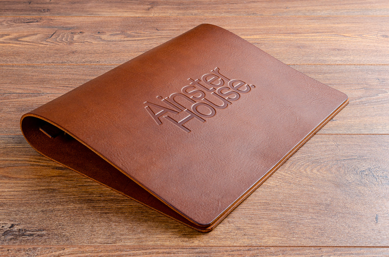 A4 leather menu with a blind deboss personalisation on the cover