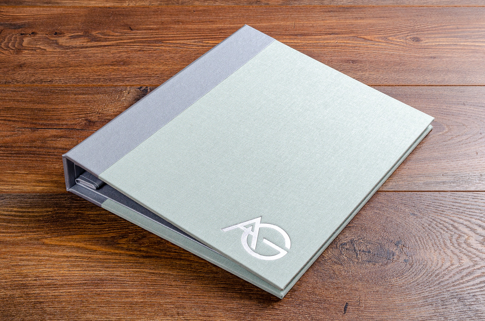 8.5 x 11 portrait portfolio book in lichen green book cloth with silver foil personalisation