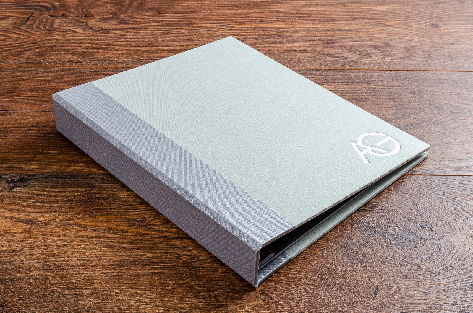 8.5 x 11 case bound portfolio book with pewter buckram spine cover