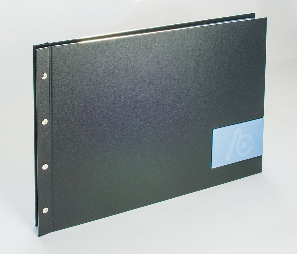 A3 landscape portfolio book with name plaque in deal blue book cloth with blind deboss personalisation