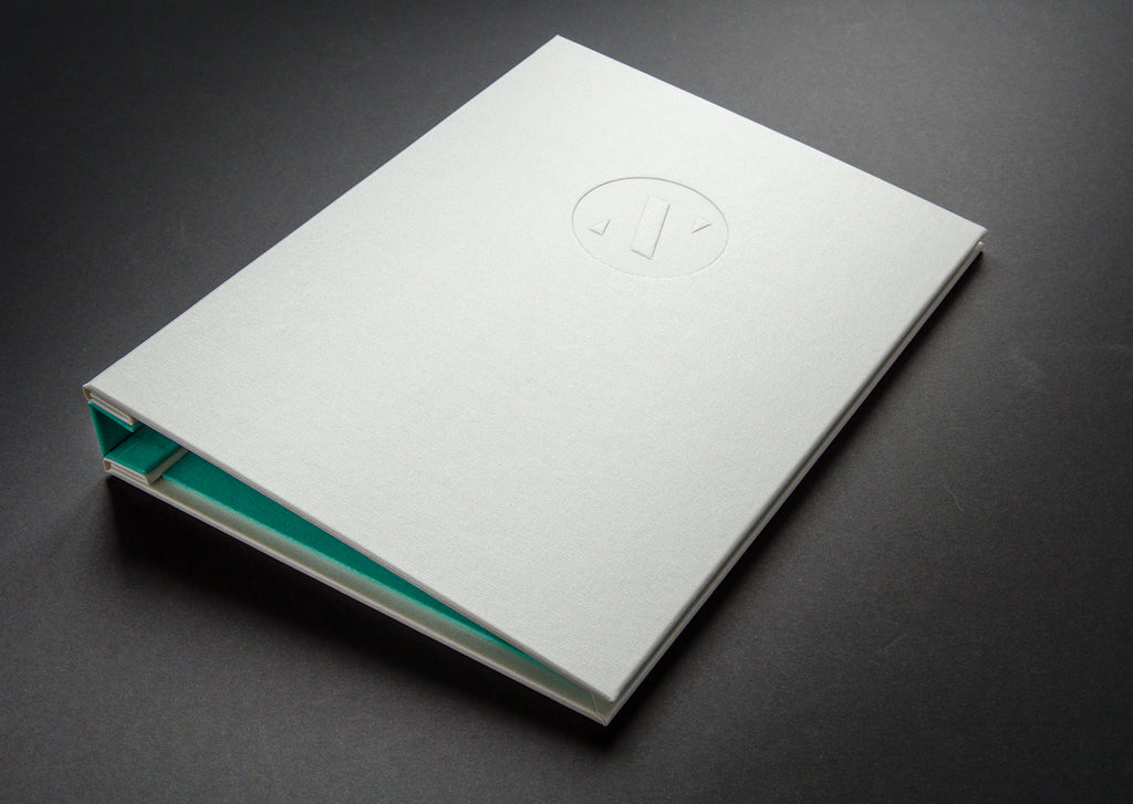 A4 Designers portfolio book in Ivory buckram and Brannan green inner bookcloth and spine cover with a blind deboss personalisation