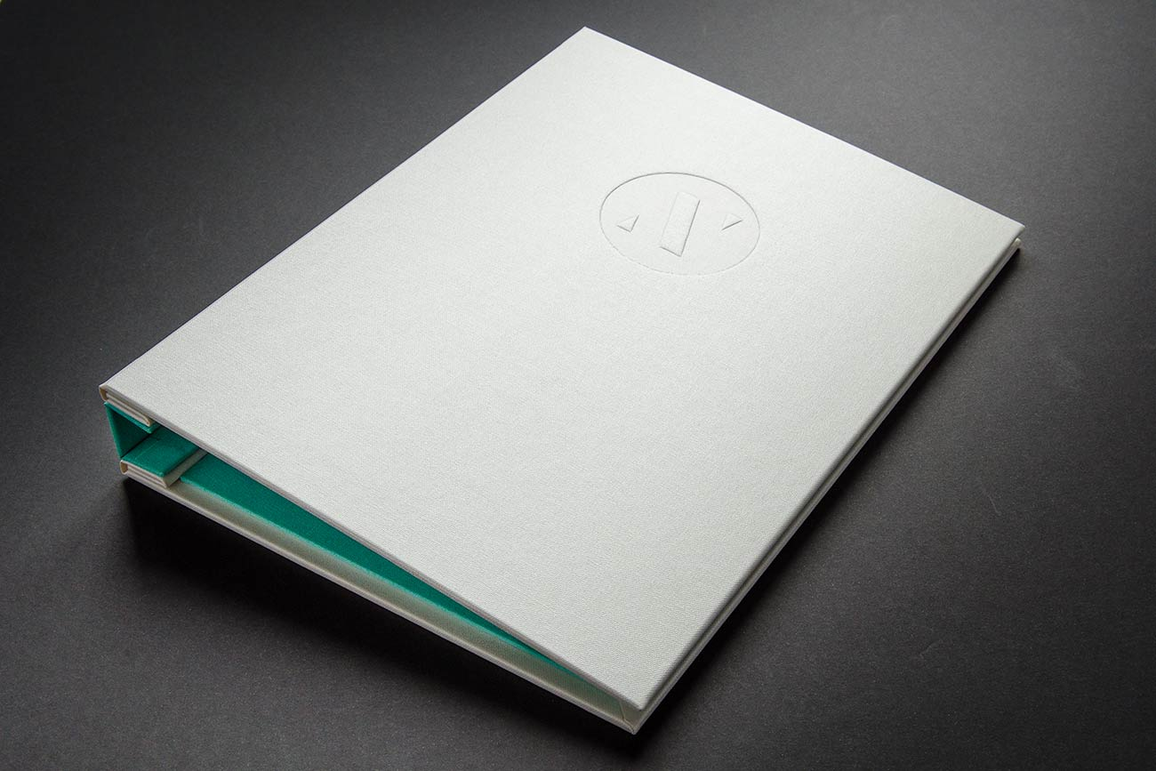 A4 graphic designers hidden screw post portfolio book - Pearl buckram cover blind deboss personalisation and brannon book cloth inner cover