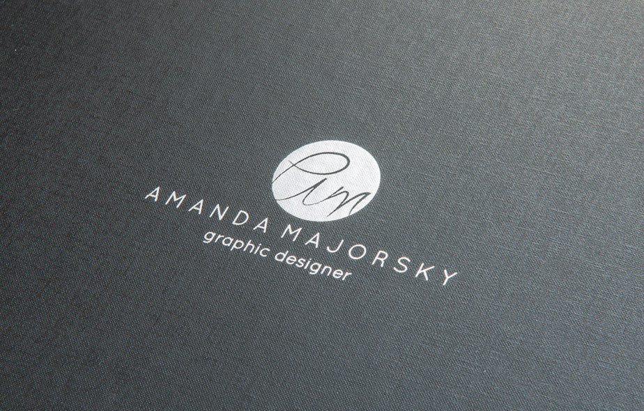 graphic designers logo stamped on her custom portfolio book by hartnack's and co