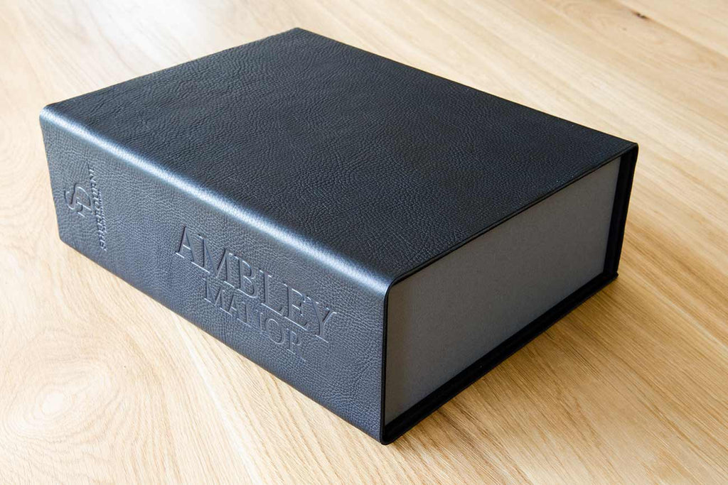 A4 leather clamshell box file in 2.5mm black leather with blind debossed cover