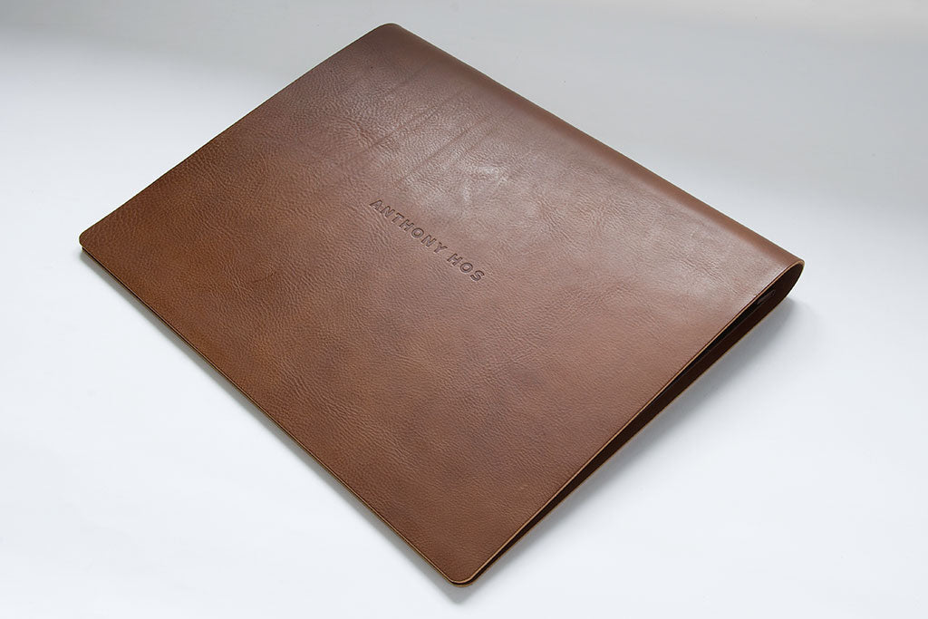 A3 flip over portfolio made from 3.5 brown leather with a blind debossed logo