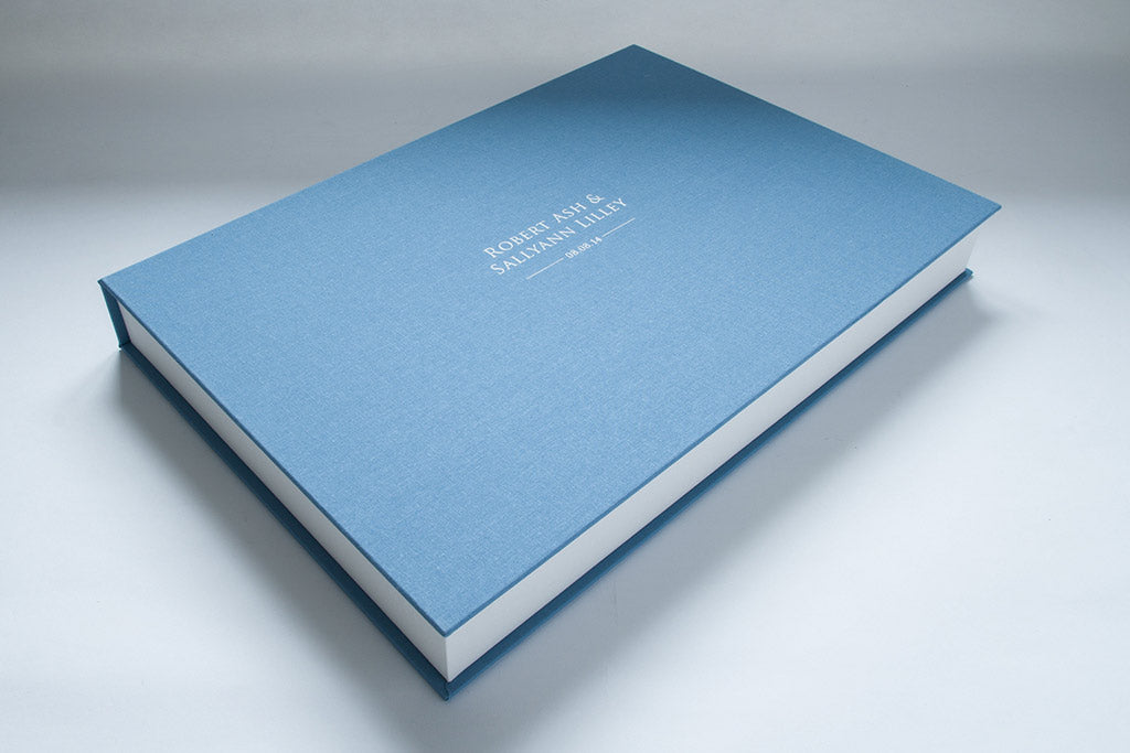 A3 Clamshell box in Deal blue book cloth with white foil stamping