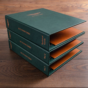 set of three vehicle history and document binders in green faux leather