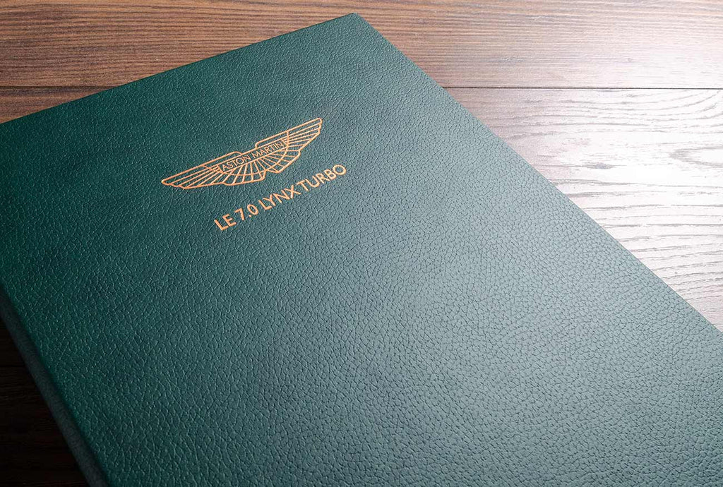 The outer covers of the binders are in Jungle green faux leather and have been foil stamped on the covers with the details of the car